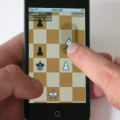 Hold and Move in Action: The thumb 'holds' the background, the index finger moves the piece
